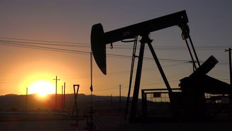 An-oil-derrick-pumps-against-the-sunset