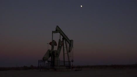 An-oil-derrick-pumps-against-the-night-sky