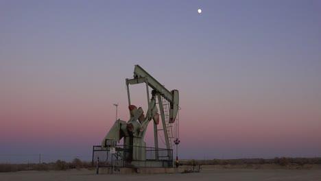 An-oil-derrick-pumps-against-the-night-sky-1