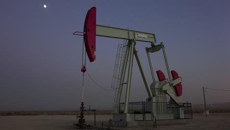 An-oil-derrick-pumps-against-the-night-sky-2