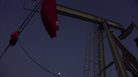Low-of-an-oil-derrick-pumping-against-the-night-sky