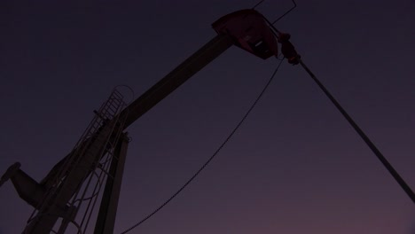 Low-of-an-oil-derrick-pumping-against-the-night-sky-1