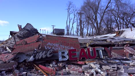 The-ruins-of-a-destroyed-beauty-salon-following-rioting-in-Ferguson-Missouri-make-an-ironic-statement-
