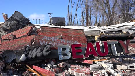 The-ruins-of-a-destroyed-beauty-salon-following-rioting-in-Ferguson-Missouri-make-an-ironic-statement-2
