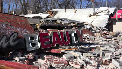 The-ruins-of-a-destroyed-beauty-salon-following-rioting-in-Ferguson-Missouri-make-an-ironic-statement-3