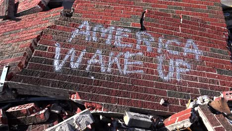 Graffiti-on-a-ruined-building-following-the-Ferguson-rioting-urges-America-to-wake-up