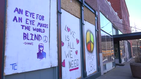 Residents-of-Ferguson-Missouri-displays-signs-supporting-their-community-following-severe-racial-tension-and-rioting-in-2014-2