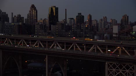 Night-shot-of-traffic-on-the-Queensboro-Bridge-with-New-York-Manhattan-skyline-background-