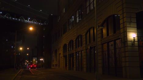 Establishing-shot-of-warehouses-under-the-Brooklyn-Bridge-with-subway-train-crossing-2