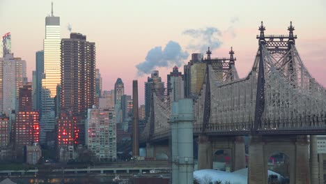 Beautiful-shot-of-Manhattan-New-York-skyline-with-Queensboro-Bridge-and-Queens-foregroun-at-dusk-or-dawn
