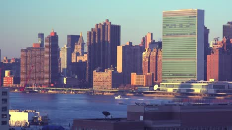 Early-morning-shot-of-the-New-York-City-Manhattan-skyline-with-the-United-Nations-building-in-the-foreground-and-boats-on-the-East-River