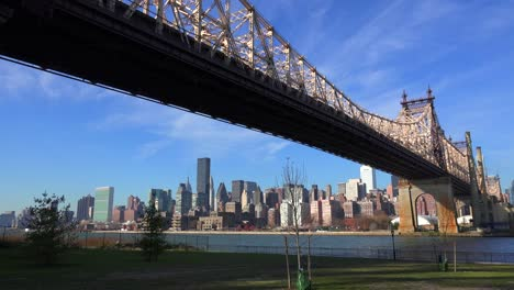 Low-angle-view-of-the-Queensboro-Bridge-with-the-New-York-skyline-background