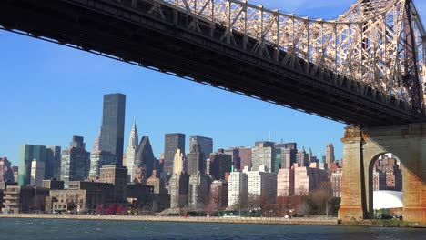 Low-angle-pullback-view-of-the-Queensboro-Bridge-with-the-New-York-skyline-background