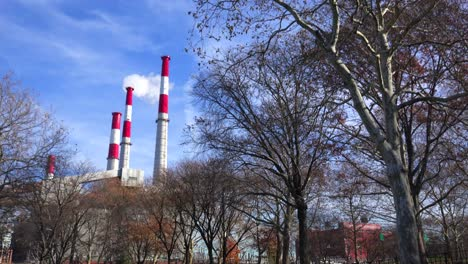 Smokestacks-from-the-Ravenswood-Generating-station-in-Queens-rise-above-a-city-park