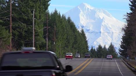 Cars-and-trucks-travel-on-a-highway-below-Mt-Hood-Oregon