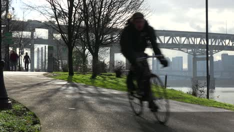 Joggers-and-bicyclists-move-along-the-Portland-Oregon-waterfront