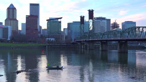 A-shot-across-the-Willamette-River-to-Portland-Oregon-with-bridge-at-dusk