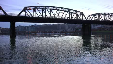 A-panning-shot-across-a-bridge-over-the-Willamette-River-in-Portland-Oregon
