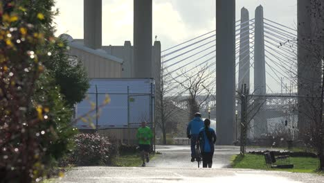 Joggers-and-cyclists-move-along-the-waterfront-in-Portland-Oregon