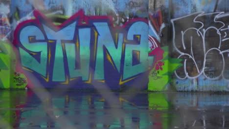 Focus-through-a-chain-link-fence-to-reveal-urban-graffiti