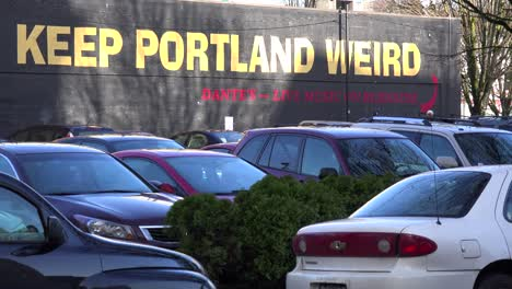 A-sign-on-a-building-urges-passersby-to-keep-Portland-weird