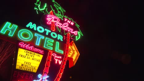 A-1950-s-neon-sign-welcomes-travelers-to-a-classic-old-roadside-motel-1