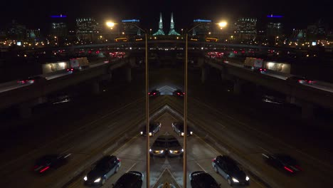 A-distorted-mirrored-shot-of-traffic-traveling-on-a-major-highway-or-freeway-at-night