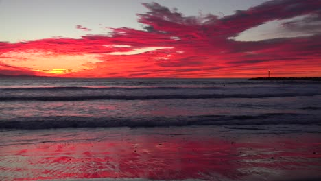 A-blood-red-sunset-illuminates-a-Southern-California-beach