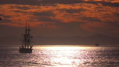 A-tall-clipper-ship-sails-at-sunset