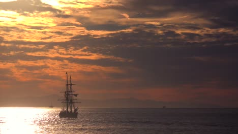 A-tall-clipper-ship-sails-at-sunset-1
