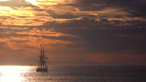A-tall-clipper-ship-sails-at-sunset-1
