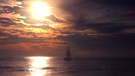 A-tall-clipper-ship-sails-at-sunset-2
