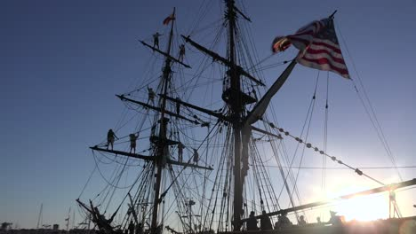 Sailors-stand-on-the-mast-of-a-tall-historic-clipper-ship-as-it-sails-on-the-ocean-1
