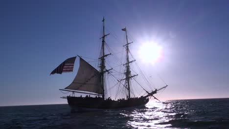 A-tall-masted-clipper-ship-sails-on-the-high-seas-with-an-american-flag-flying-2