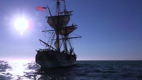 A-tall-masted-clipper-ship-sails-on-the-high-seas-against-the-sun-1