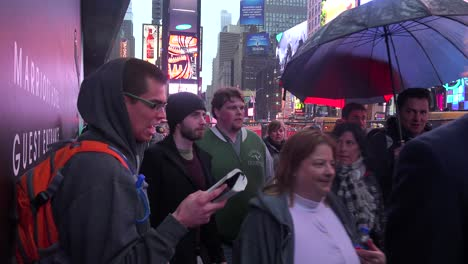 A-man-stands-in-Time-Square-New-York-City-and-reads-passages-from-the-Bible