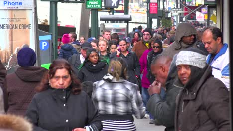 Crowds-of-people-pass-a-homeless-person-on-the-streets-of-Manhattan-New-York-City-without-noticing-