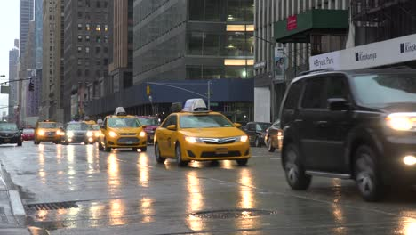 Cars-pass-on-wet-streets-in-midtown-Manhattan-New-York-city