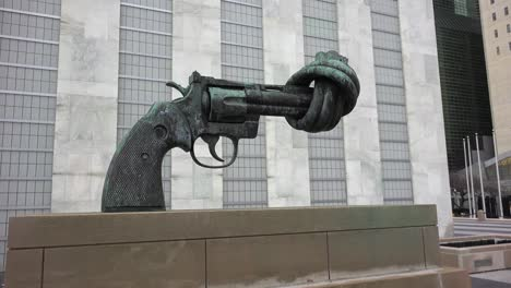 A-gun-sculpture-with-a-twisted-barrel-sits-outside-the-United-Nations-Building-in-New-York