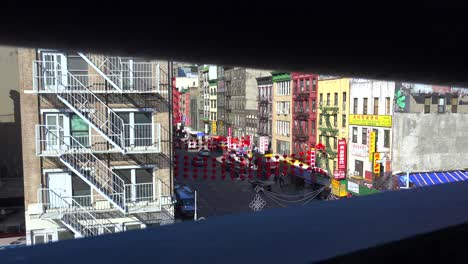 Establishing-high-angle-shot-of-the-Chinatown-district-with-lamps-and-lanterns-in-New-York-City-1