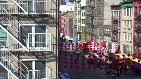 Establishing-high-angle-shot-of-an-apartment-in-the-Chinatown-district-with-lamps-and-lanterns-in-New-York-City