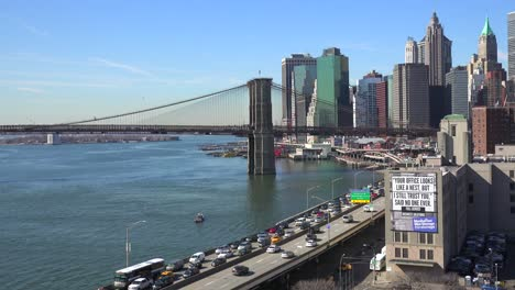 The-Brooklyn-Bridge-East-River-and-FDR-parkway-on-a-clear-sunny-day-in-New-York-City