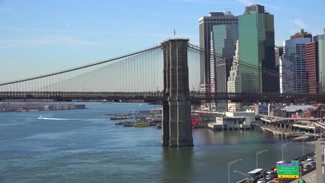 The-Brooklyn-Bridge-East-River-and-FDR-parkway-on-a-clear-sunny-day-in-New-York-City-1