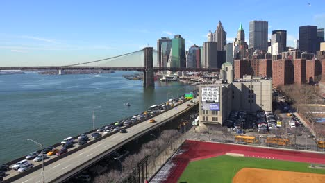 The-Brooklyn-Bridge-East-River-and-FDR-parkway-on-a-clear-sunny-day-in-New-York-City-2