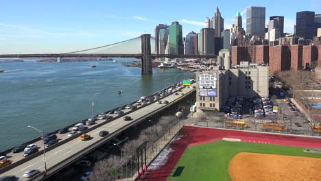 The-Brooklyn-Bridge-East-River-and-FDR-parkway-on-a-clear-sunny-day-in-New-York-City-3
