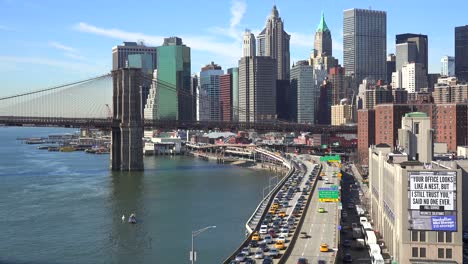 The-Brooklyn-Bridge-East-River-and-FDR-parkway-on-a-clear-sunny-day-in-New-York-City-4