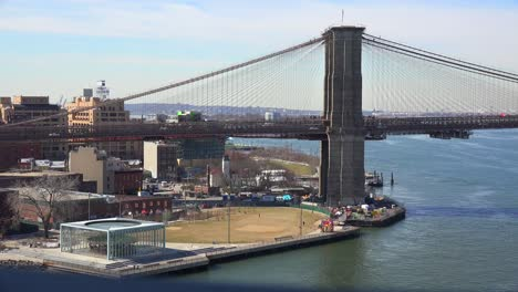 A-boat-passes-under-the-Brooklyn-Bridge-in-New-York-City-1