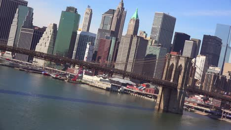Tilted-angle-shot-of-New-York-City-with-Brooklyn-Bridge-foreground