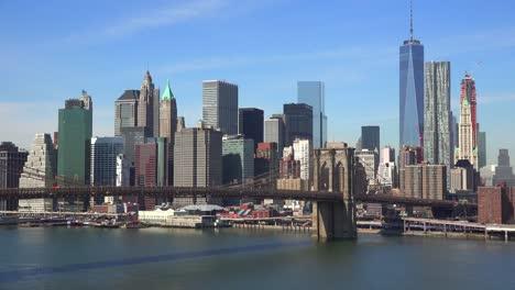 Nice-establishing-shot-of-New-York-City-financial-district-with-Brooklyn-Bridge-foreground-2
