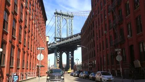 An-establishing-shot-of-the-Dumbo-area-of-Brooklyn-New-York-including-the-Manhattan-bridge-in-distance